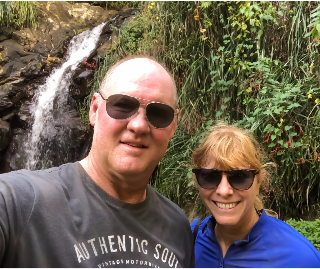 couple in front of waterfalls Sandals Grenada dune buggy excursion